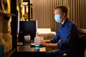 Young Businessman With Mask For Protection From Corona Virus Outbreak Working From Home During Quarantine